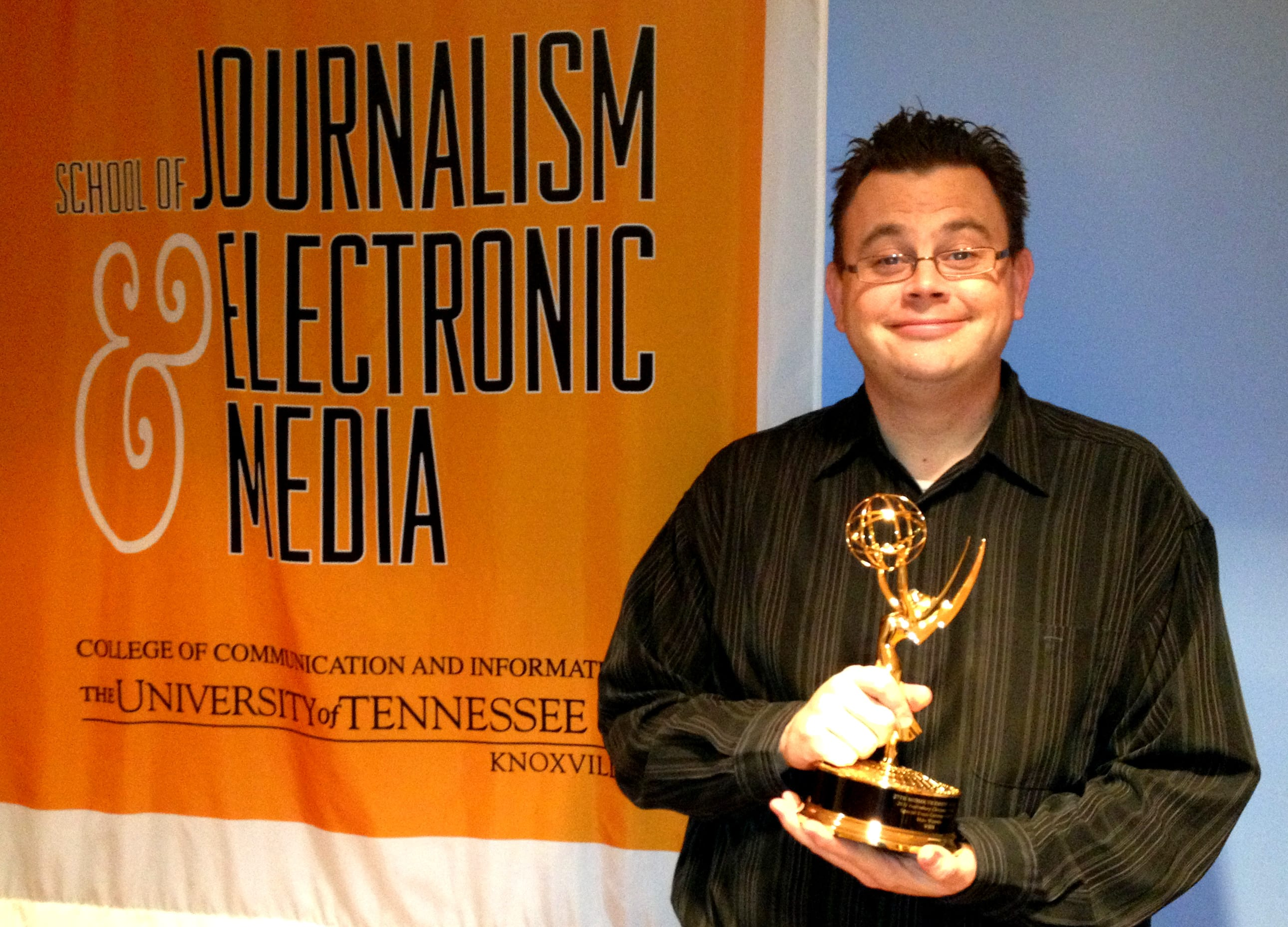 Mike Wiseman with his Emmy Award in the Converged News Lab