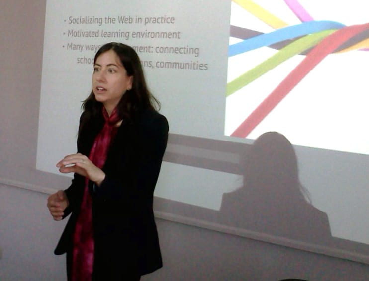 Lecturer Melanie Faizer presents at the 2013 Media Convergence conference in Romania.