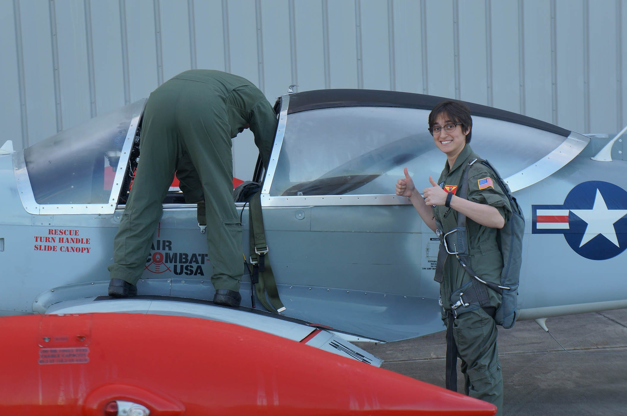 Miriam Kramer flashes a thumbs up before taking flight in a Marchetti SF 260 fighter jet. Photo courtesy of SPACE.com.
