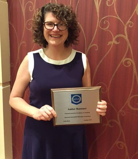 Dr. Amber Roessner with her award at the 2017 AJHA convention.