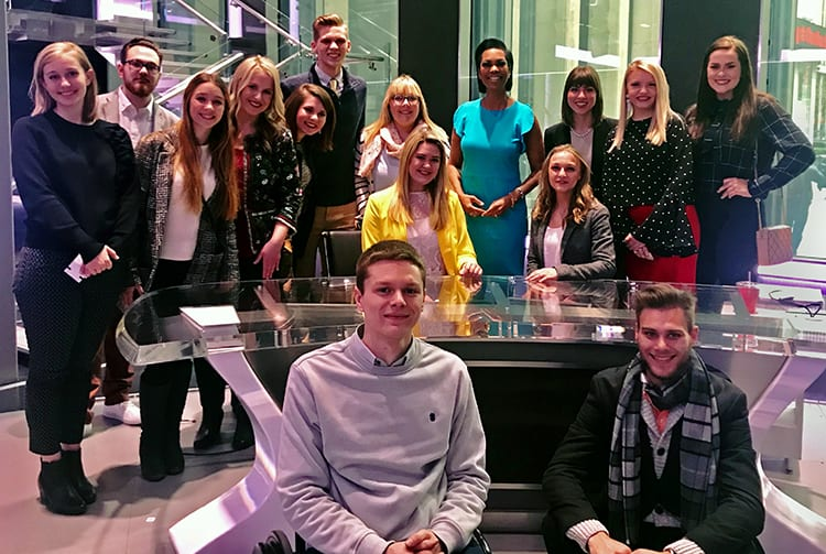 Students meet Harris Faulkner (in blue), anchor of Outnumbered Overtime, at the Fox News headquarters.