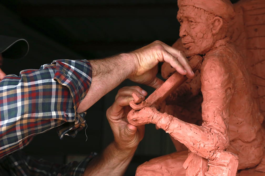 """LaFollette sculptor William Sarno puts love and care into his sculpture of Howard """"Louie Bluie"""" Armstrong. Photo by Deja Lytle."""